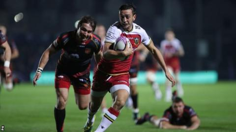 Northampton scrum-half Alex Mitchell outstripped the Dragons defence to score the second try