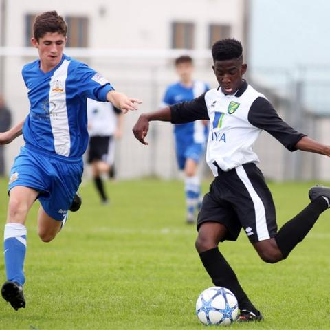 Glenavon's Matthew Shearer closes in on Norwich City opponent Shaye La Rose during an Under-15 match which the team from Lurgan won 4-3