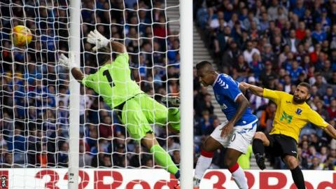 Alfredo Morelos scores a headed goal for Rangers
