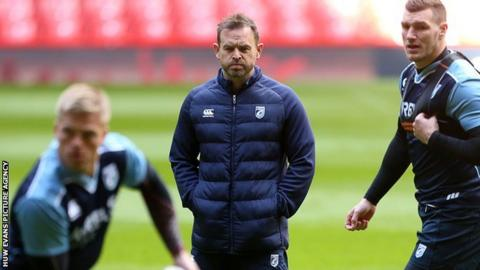 Danny Wilson watches his players preparing for their Judgement Day match with Ospreys