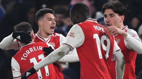 Arsenal's players celebrate after equalising against Chelsea