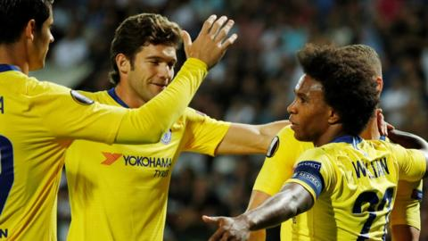 Willian celebrates with his team-mates after scoring for Chelsea