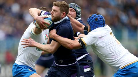 Finn Russell is tackled