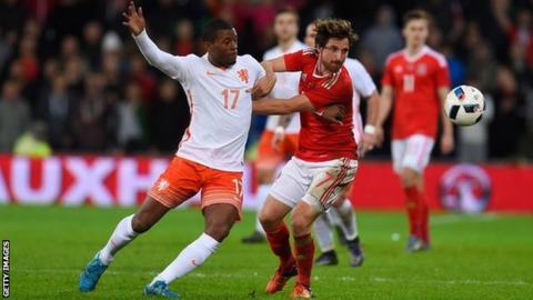 Netherlands player Georginio Wijnaldum and Joe Allen of Wales