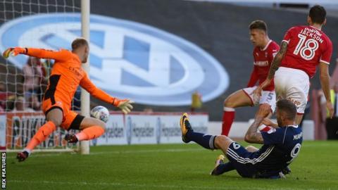 Daryl Murphy heads Nottingham Forest's first-half equaliser against Barnsley
