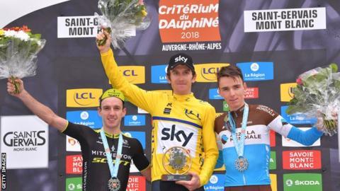 Geraint Thomas (c) celebrates victory over Adam Yates (R) & Romain Bardet (L)