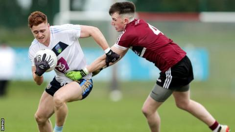 UCD's Tyrone forward Conor Meyler attempts to get away from St Mary's Miceal Rooney