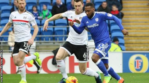 Cardiff City's Junior Hoilett is tackled by Kevin McDonald