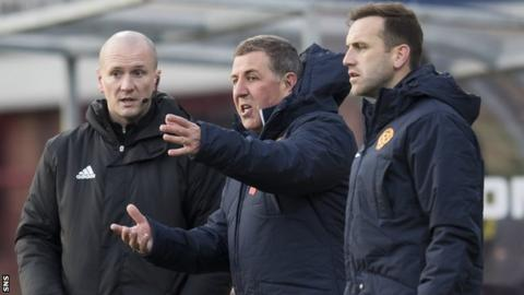 Mark McGhee flanked by a match official and James McFadden