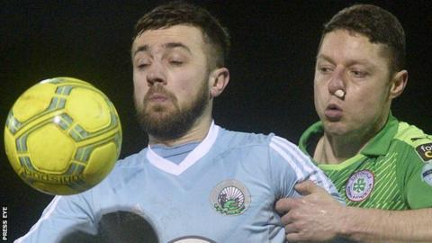 Warrenpoint's Conor McMenamin is challenged for possession by Cliftonville's Shane Grimes