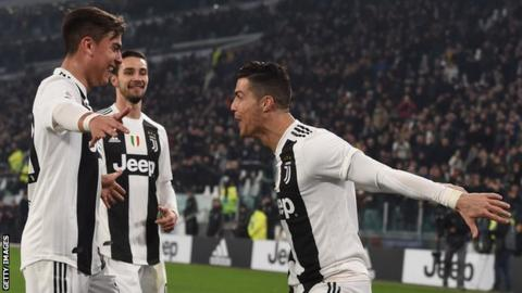 Paulo Dybala and Cristiano Ronaldo celebrate the latter's goal in Juventus' Serie A win over Frosinone