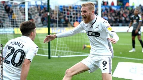 Swansea City striker Oli McBurnie celebrates scoring against Reading with Dan James (left)