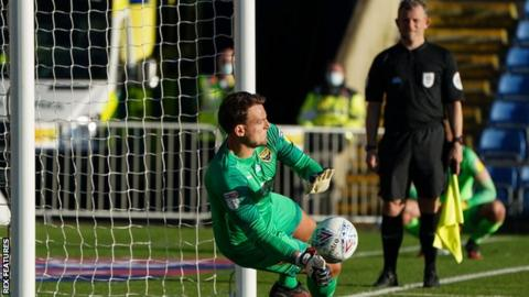 Simon Eastwood saves a penalty