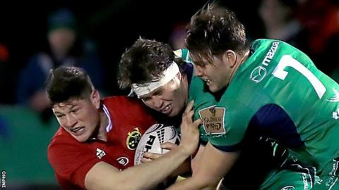Munster's Jack O'Donoghue is tackled by Connacht's Jake Heenan and James Cannon