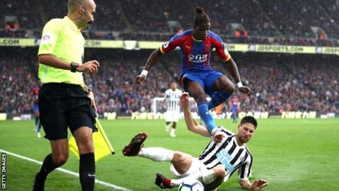 Wilfried Zaha in action against Newcastle