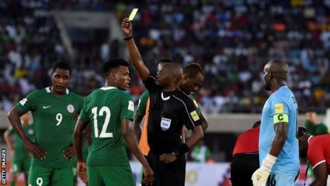 Nigeria's Abdullahi Shehu shown a yellow card against Zambia