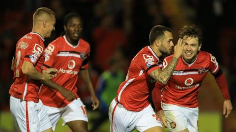 Walsall players celebrate Milan Lalkovic's equaliser in the League Cup win over Brighton