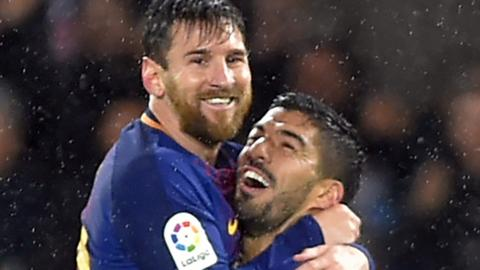 Lionel Messi and Luis Suarez