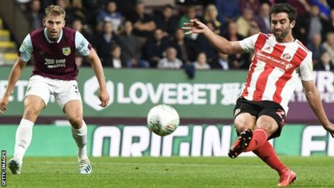 Will Grigg (right) scores for Sunderland