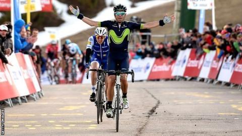Movistar's Spanish rider Alejandro Valverde (R) celebrates as he crosses first the finish line followed by Quick Step Floors' Irish rider Daniel Martin