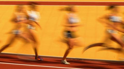 Female athletes competing on the track