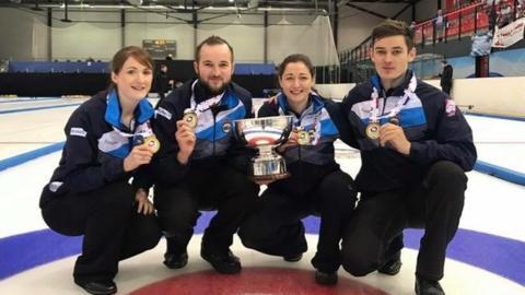 Scotland's Barbara McFarlane, Billy Morton, Rhiann Macleod and Grant Hardie hold the World Mixed Curling trophy