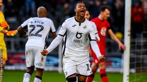 Rhian Brewster celebrates after scoring for Swansea