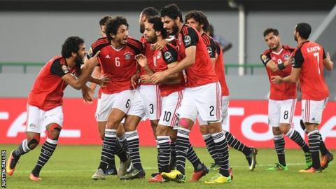 Mohamed Salah is surrounded by team-mates after scoring