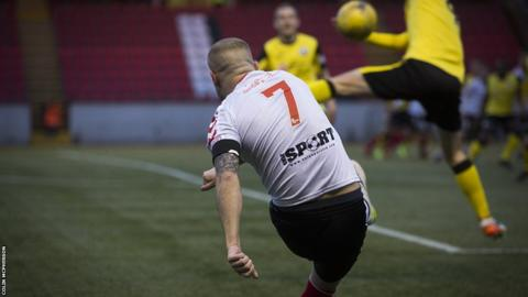 Clyde's Scott Linton fires in a cross which is blocked by a City defender.