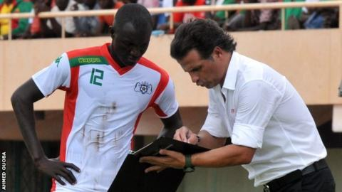 Midfielder Adama Guira with coach Paulo Duarte