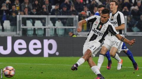 Paulo Dybala scores a penalty for Juventus