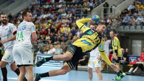 Mannheim, Germany, 10 May: Hendrik Pekeler produces an acrobatic finish for Rhein-Neckar Loewen against SC Magdeburg in their DKB handball match at SAP Arena, helping his side to a 34-29 win.