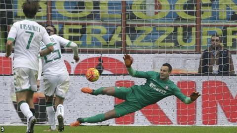 Sassuolo's Domenico Berardi beats Inter Milan goalkeeper Samir Handanovic from the penalty spot