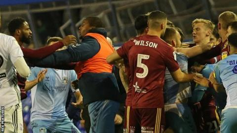 Ipswich and Coventry players fight