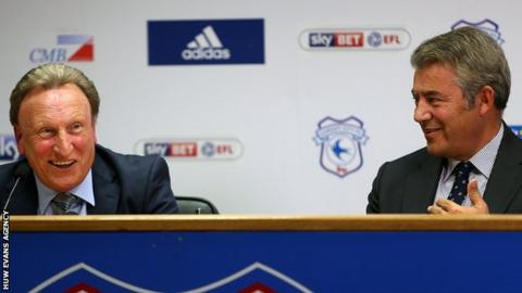 Neil Warnock and Mehmet Dalman smile (R) on the day Warnock held his first press conference as Cardiff boss in October, 2016