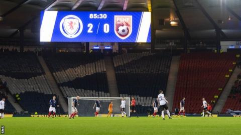 The Hampden scoreboard shows '2-0' at Scotland's game with Albania