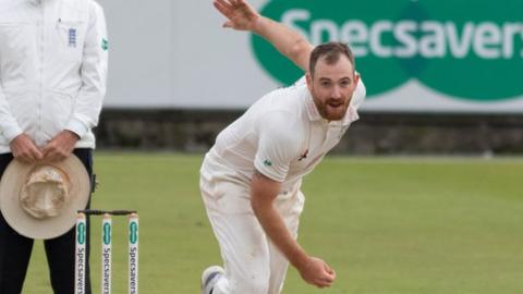 Ben Raine bowling for Durham