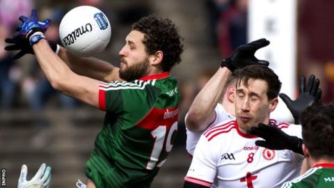 Tyrone's Colm Cavanagh was shown a black card for hauling down Mayo's Tom Parsons