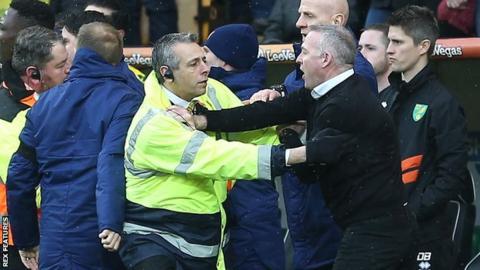 Ipswich manager Paul Lambert is calmed down by a steward