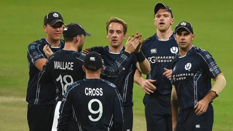 Scotland celebrate a wicket