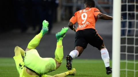 Lorient's Ghanaian forward Abdul Majeed Waris (R) scores for Lorient against Metz on 22 April, 2017