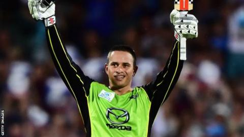 Usman Khawaja celebrates his century
