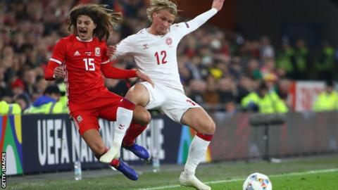 Ethan Ampadu is fouled by Denmarlks Kasper Dolberg