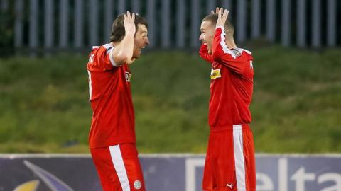 Cliftonville's double goalscorer David McDaid celebrates with Martin Donnelly during the 3-1 win over Ballinamallard