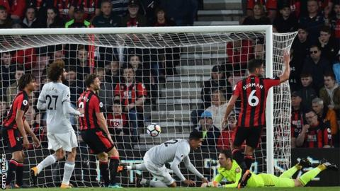 Chris Smalling slides in to give Manchester United the lead at Bournemouth