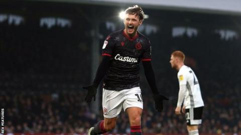 Reading's John Swift celebrates his first-half goal against Fulham