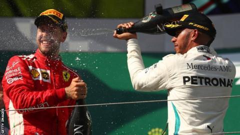 Sebastian Vettel and Lewis Hamilton on the podium at the Hungarian Grand Prix