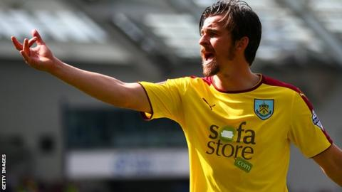 Joey Barton makes a point playing for Burnley against Brighton