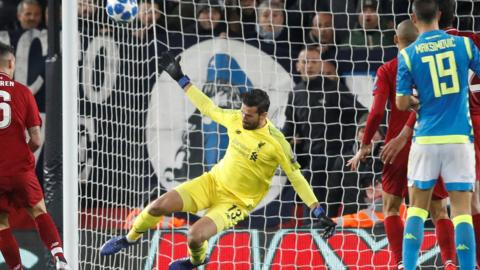 Liverpool goalkeeper Alisson makes a save against Napoli