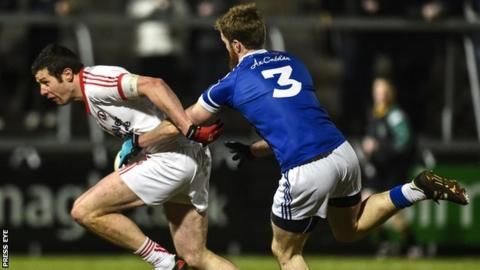 Tyrone's Sean Cavanagh attempts to burst away from Cavan's Rory Dunne in this year's McKenna Cup final